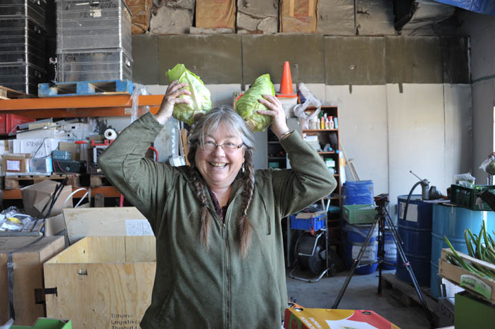 Sarah the cook in the ware house in Kangerlussuaq packing food - and having a little fun